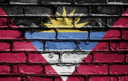 The flag of Antigua and Barbuda painted on a brick wall