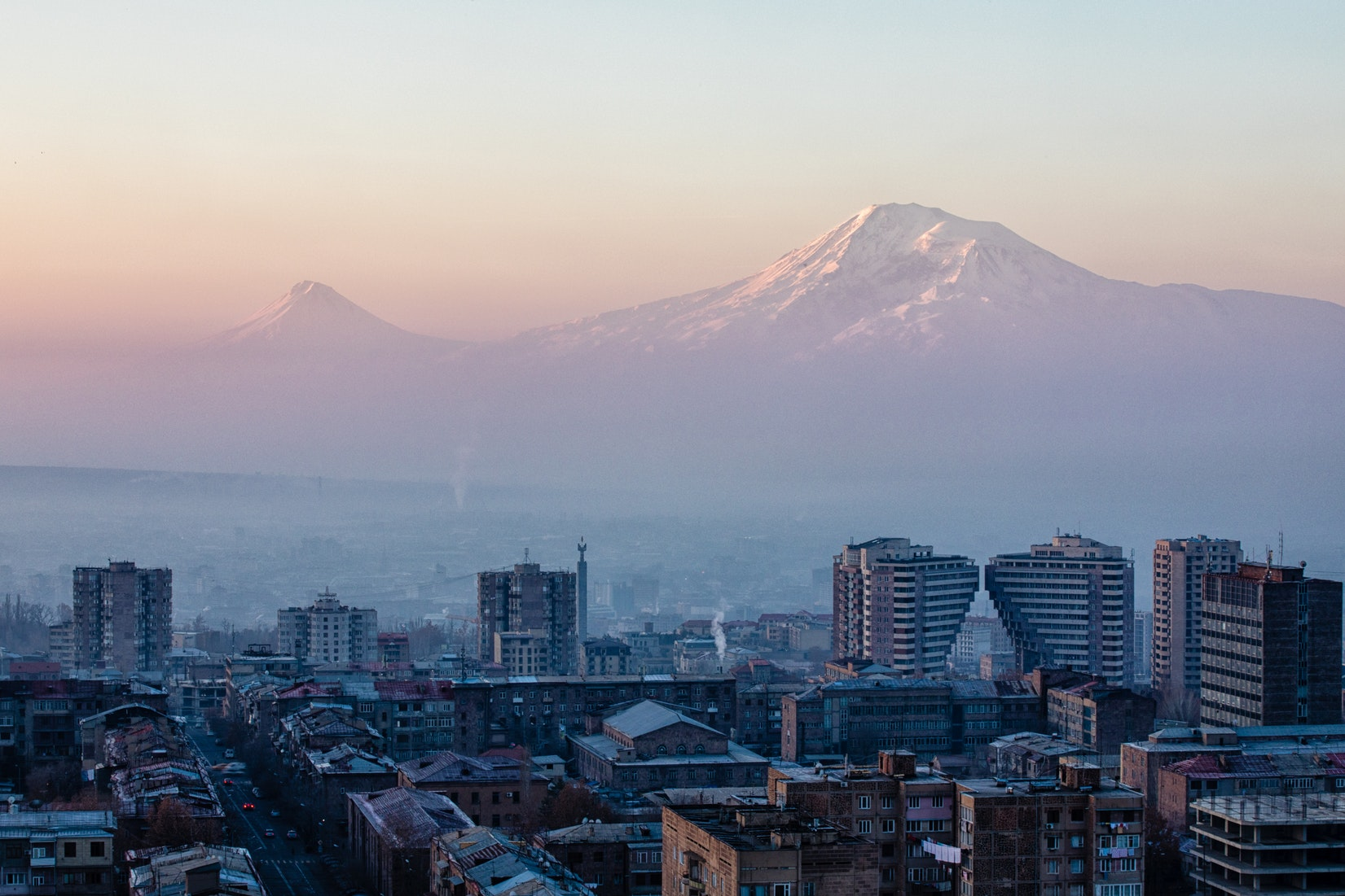 The Armenian city of Yerevan with mountains in the distance