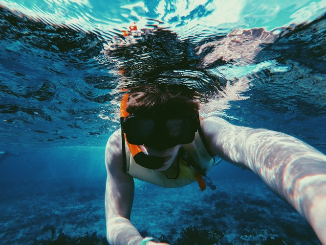 Scuba diver recording on a go pro