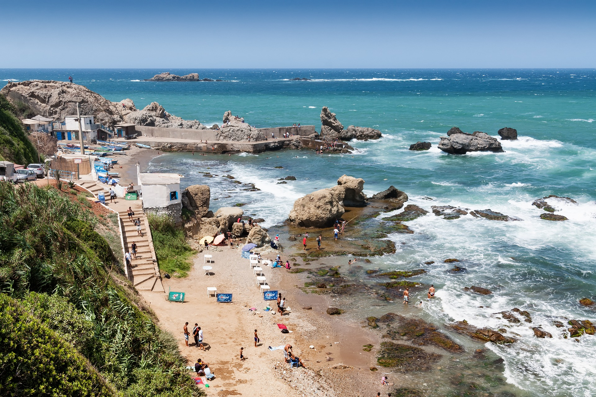 Algerian coast with a view on the Mediterranean and people on the beach.
