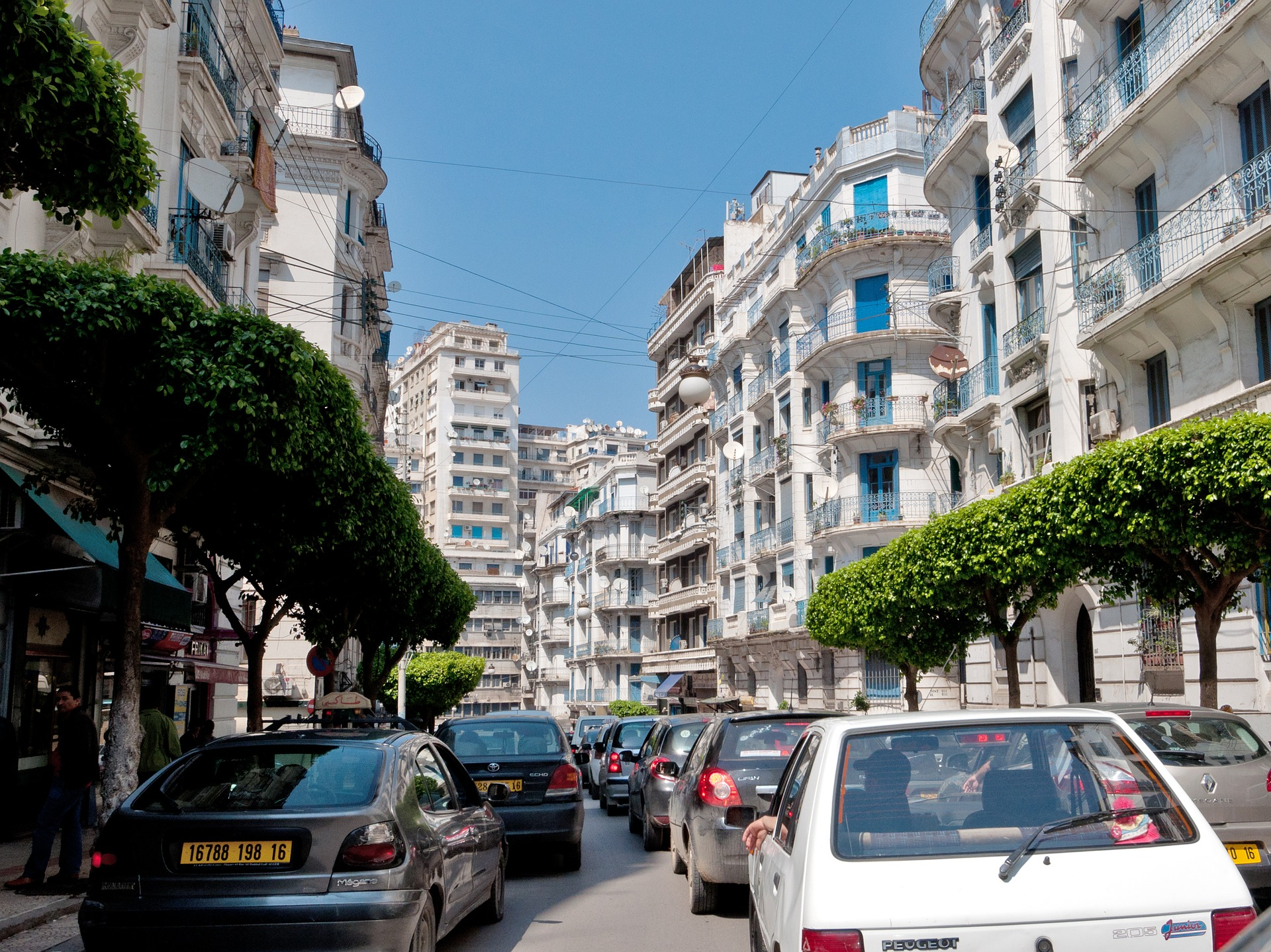 Street view with high blocks overlooking pedestrians and vehicles