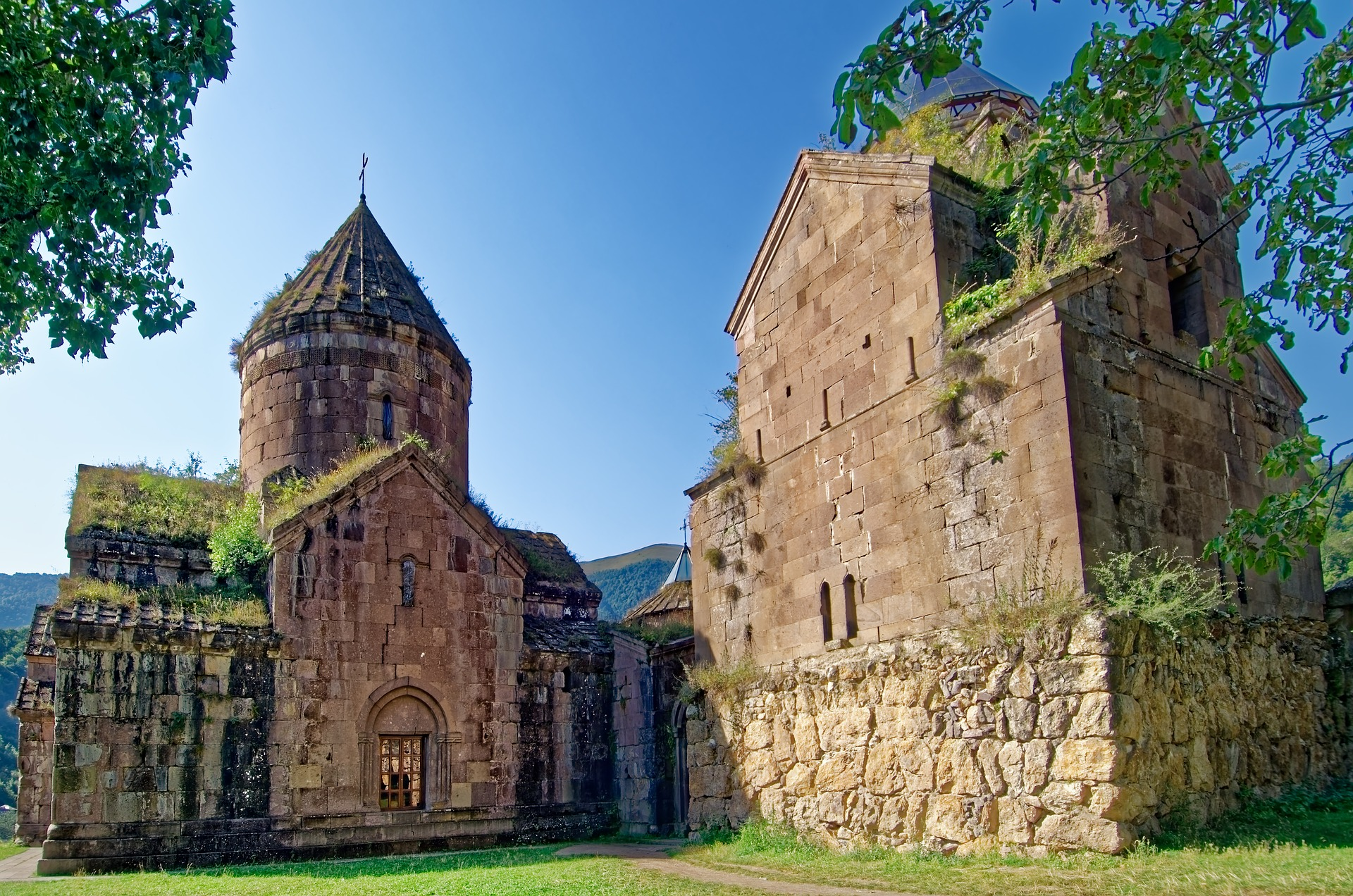 View of an old monastery in Armenia with mountains in the distance
