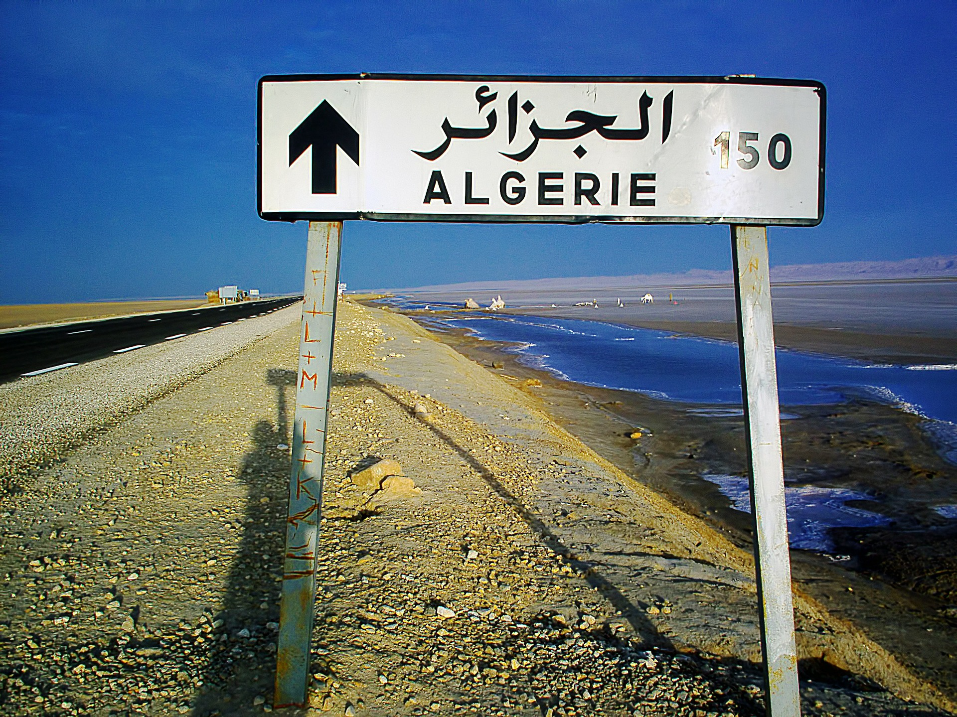 Road sign on a motorway showing distance to Algiers