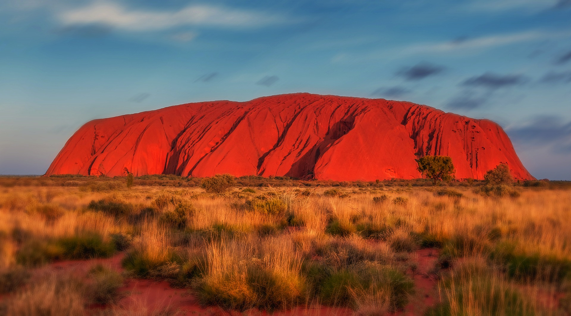 Uluru surrounded by outback plains