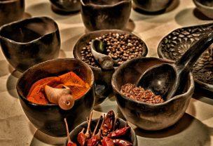 Various spices inside ceramic bowls