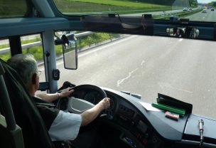 Image of a bus driver driving his bus