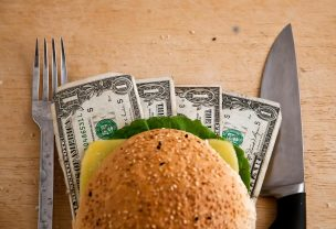 US dollars in a hamburger bun, close-up